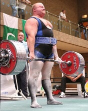 Repetitive heavy lifting repeatedly pulls down on the shoulder, increases the risk of a SLAP lesion